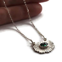Textured silver floral necklace with green tourmaline gemstone