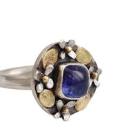 Tanzanite ring with gold and floral details
