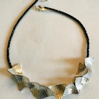 Faceted Spinel and textured silver