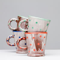 Slip decorated earthenware expresso cups.