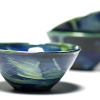 Sky series slip decorated pudding size bowls.
