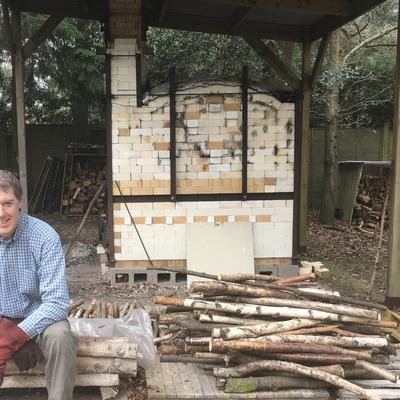 Potter and wood-fired kiln