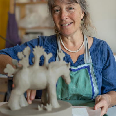 Sadie in her studio working on a ceramic sculpture