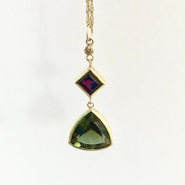 Gold pendant set with diamond, garnet & moldavite